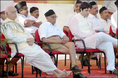 Senior RSS functionary M G Vaidya is seen sitting between Advani and Varun  # BJP youth leader Varun Gandhi, who became the first member of the Gandhi family to ever attend a saffron rally at the RSS headquarters.