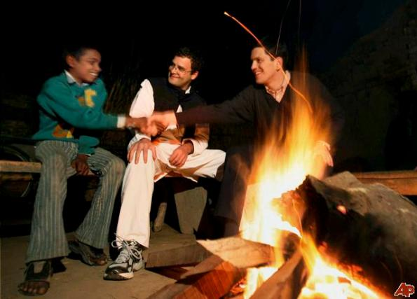 "DoBritish Foreign Secretary David Miliband, right, shakes hands with a village boy, as Indian lawmaker Rahul Gandhi looks on in Semra village, India, Wednesday, Jan. 14, 2009. Miliband spent a night in the house of a Dalit family, the group once known in India as ""untouchables,"" at the invitation of Gandhi, according to news reports. ( we see a modern Mahatma in Making."