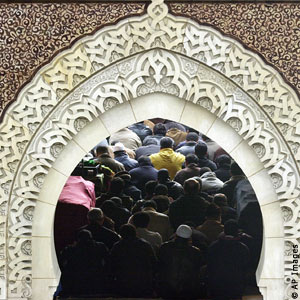 Muslims in Congregation in a Mosque In Paris France during the month of Ramadan, Celebrating Salat the Taraweeh Prayers, and showing Obidience to Allah The Lord of all Universes and Master of Day of Judgement.