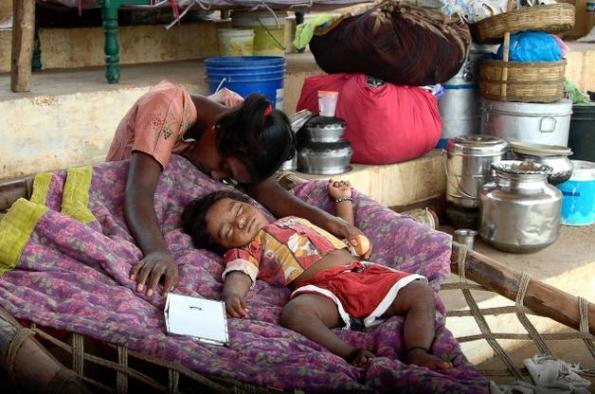 Children in a Relief Camp in Vijayawada fall asleep in shear exhaustion.