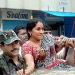 A lady helped by Army to Reach to safty in Kurnool Town
